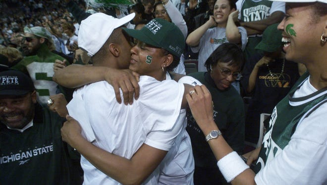 Michigan State's  Morris Peterson, left, gets a hug  from his mom  after  MSU's  win over Iowa State on Saturday, March 25, 2000 at The Palace of Auburn Hills.