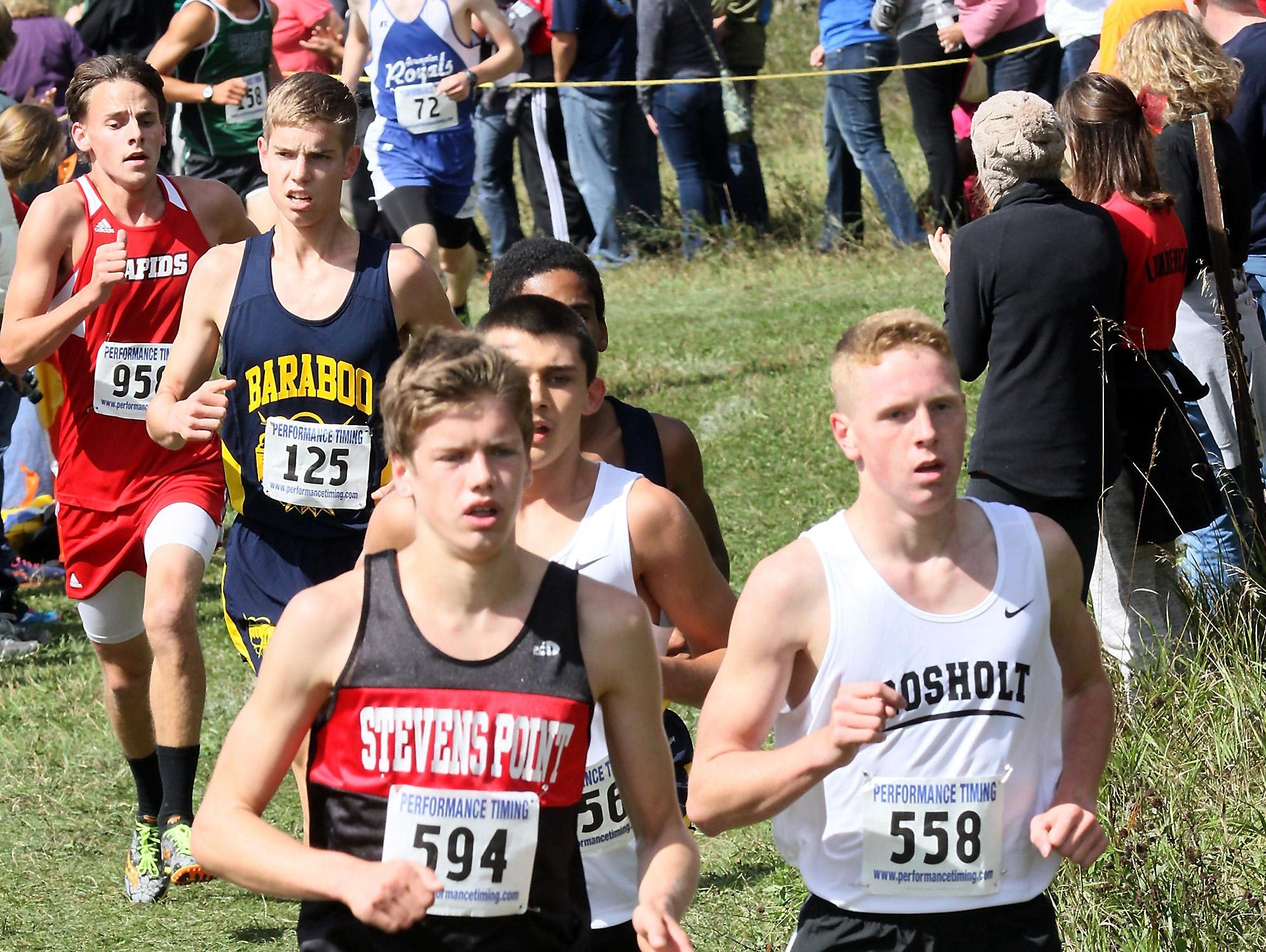 Liam Belson, SPASH, left and Adam Rzenkowski, Rosholt, run together early in the the SPASH Invitational Saturday at Standing Rocks County Park near Plover.
