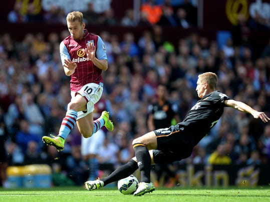 Aston Villa's Andreas Weimann, left, battles for the ball with Hull City's Michael Dawson, during their English Premier League soccer match at Villa Park, Birmingham, England, Sunday, Aug. 31, 2014. (AP Photo/Martin Rickett, PA Wire)     UNITED KINGDOM OUT   -   NO SALES    -    NO ARCHIVES