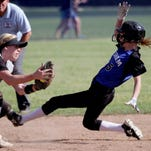 Gresham's Jasmine Kleiboeker (5) slides safely into second past McNary's Kelsi Christenson (27) in the Gresham vs. McNary softball game, in the first round of the OSAA class 6A state playoffs, at McNary High School in Keizer on Monday, May 25, 2015. McNary won the game 11-7.