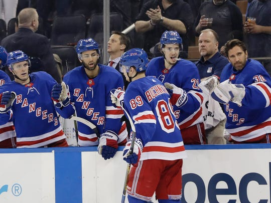 New York Rangers' Pavel Buchnevich (89) celebrates with teammates after scoring a goal during the second period of the team's NHL hockey game against the St. Louis Blues on Friday, March 29, 2019, in New York. (AP Photo/Frank Franklin II)