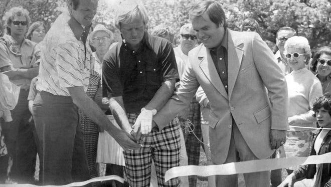 Tom Weiskopf, left, and Jack Nicklaus, center, officially open Muirfield Village Golf Club in 1974.