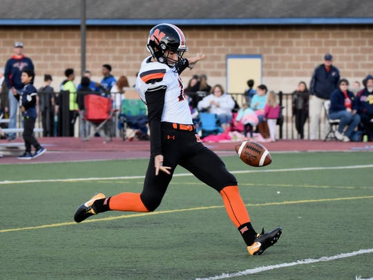 Northville's Jake Moody attempts a punt in a game this