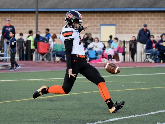 Northville's Jake Moody attempts a punt in a game this season. A standout kicker, he is averaging 42.8 yards per punt this season.