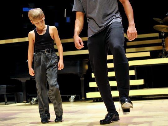Jake Sweeny, 9, of Newark, watches as he learns a new step combo from John Manzari, 22, of Washington, D.C., right, during a rehearsal for Maurice Hines is Tappin' Thru Life.