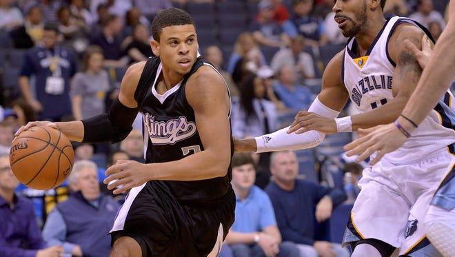 Sacramento Kings guard Ray McCallum, left, drives against the Memphis Grizzlies on March 30, 2015, in Memphis, Tenn.
