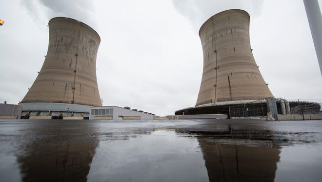 Shown are a cooling towers at the Three Mile Island nuclear power plant in Middletown, Monday, May 22, 2017. (AP Photo/Matt Rourke)