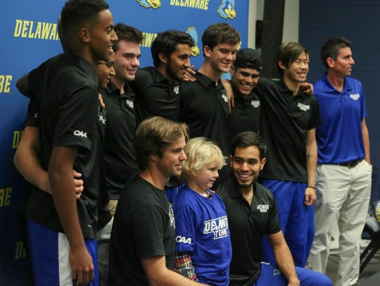 The Delaware men's tennis team gathers for a photo