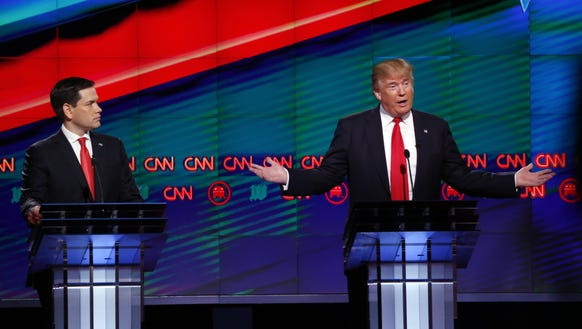 Republican presidential candidate Donald Trump answers