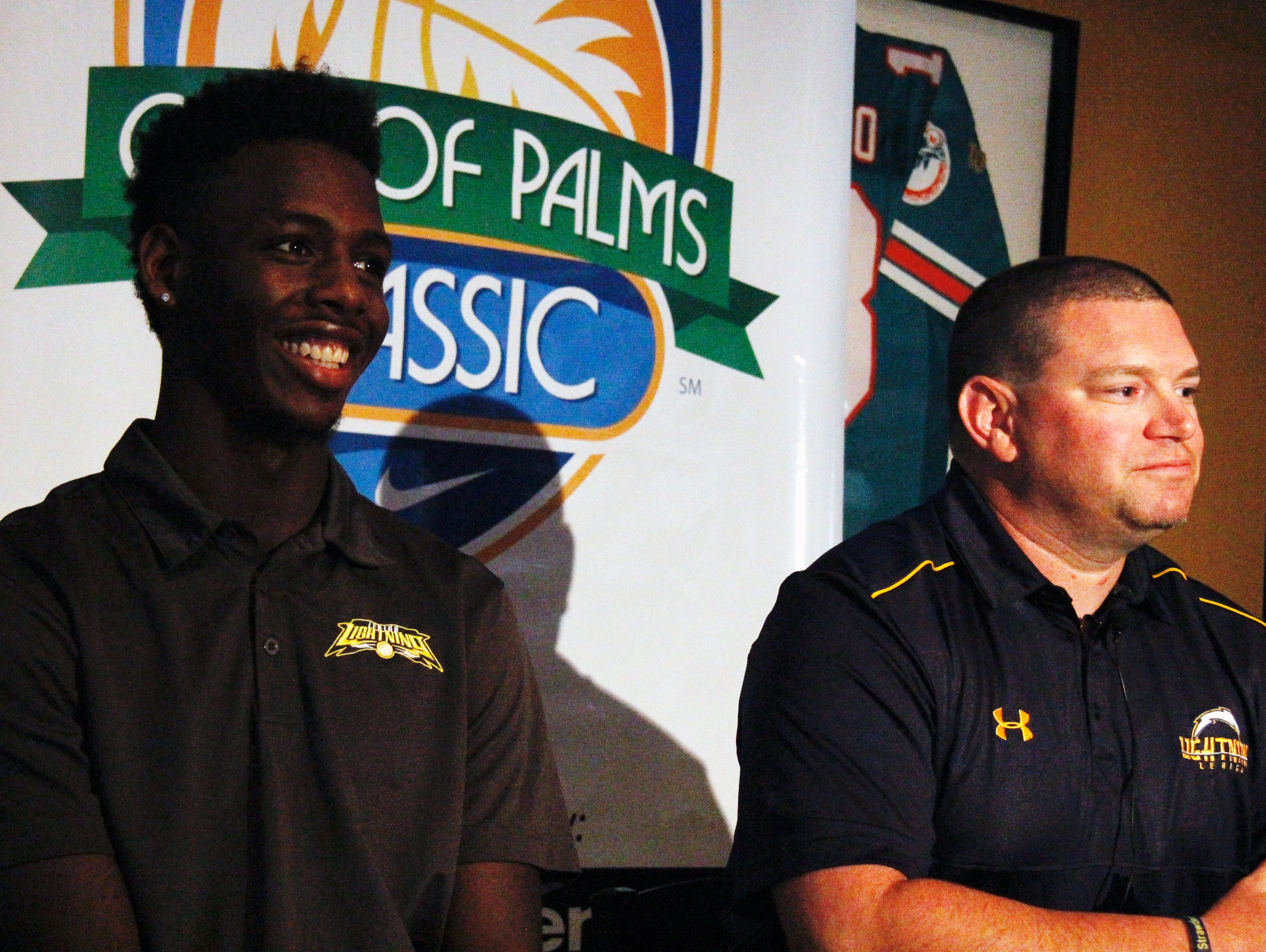 Lehigh Senior head coach Greg Coleman, right, and senior forward Jarvis Martin speak during a news conference at Shoe Less Joe's Cafe in Fort Myers for the introduction of this years field in the 2016 City of Palms Basketball Classic on Wednesday.