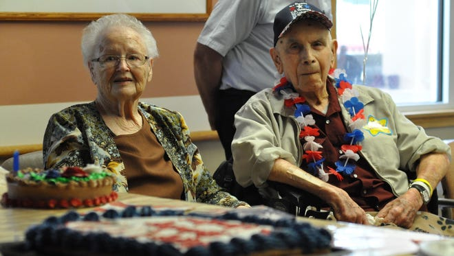 Lou E. Warshaw (left) sits on Friday with her husband, World War II veteran George Warshaw. George Warshaw turned 102 on Sunday, and a celebration was held Friday at the Alexandria VA Community Living Center.