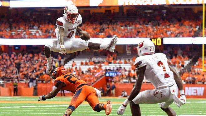 Lamar Jackson's breakout came last season against Syracuse, including this touchdown run in which he leaped over a SU defensive back.