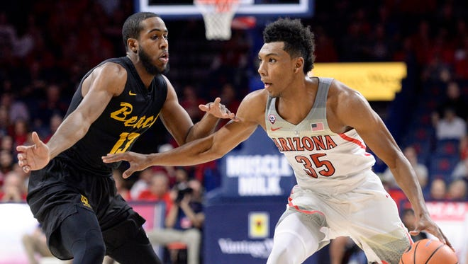 Nov 29, 2017; Tucson, AZ, USA; Arizona Wildcats guard Allonzo Trier (35) dribbles the ball as Long Beach State 49ers forward Barry Ogalue (13) defends during the first half at McKale Center. Mandatory Credit: Casey Sapio-USA TODAY Sports
