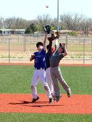 Monday's Albuquerque Baseball Academy Camp works on hitting and fielding drills.