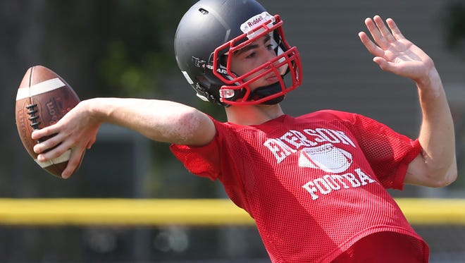 Quarterback, Peter Durocher lofts one up during practice.