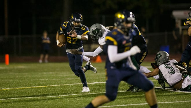 """Naples junior running back Cesare """"chez"""" Mellusi runs the ball during the game against Palmetto Ridge at Naples High on Thursday, Sept. 28, 2017."""