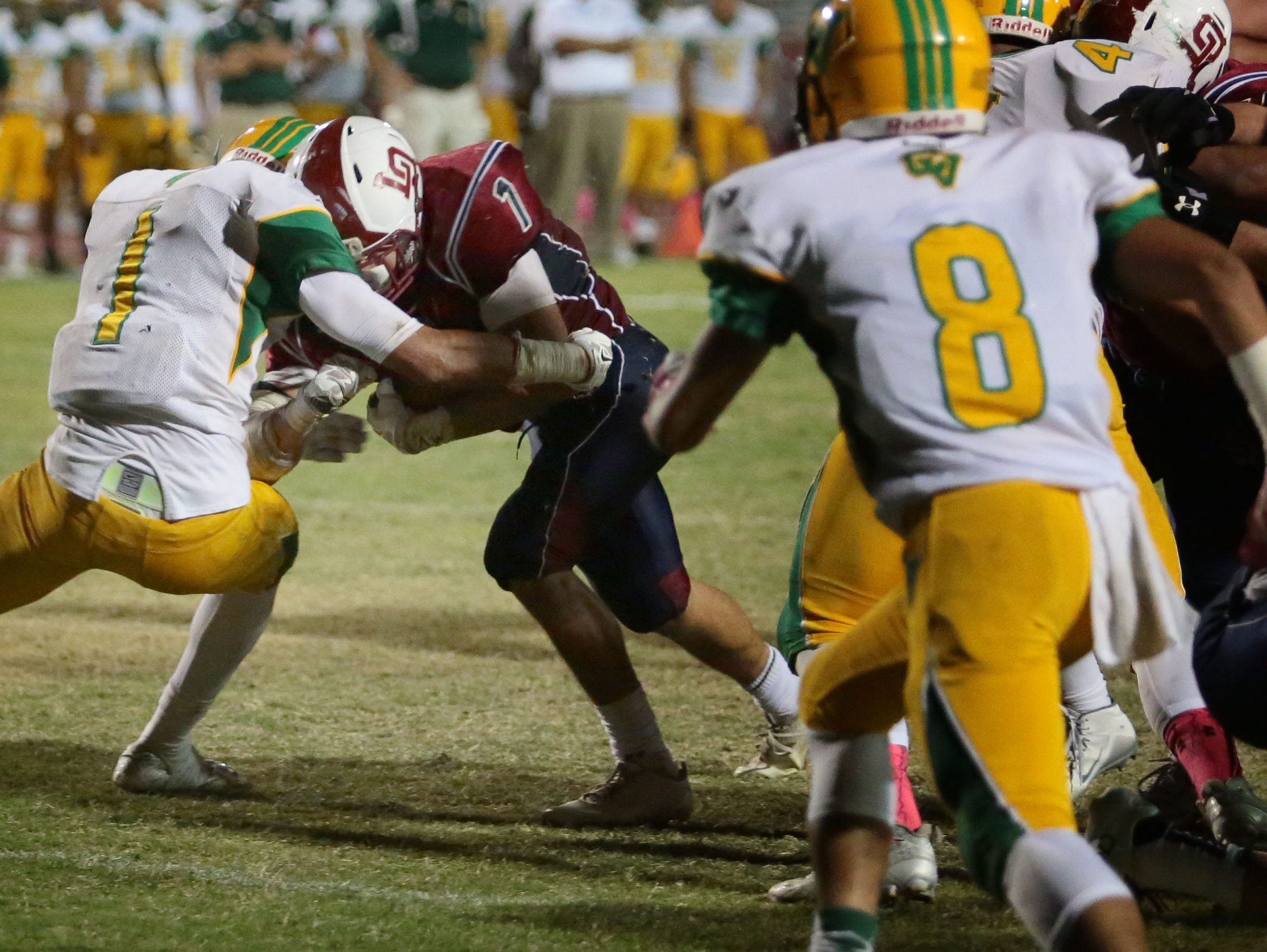La Quinta's Benji Cordova carries the ball for a 3 yard touchdown against Coachella Valley in the 2nd quarter on Friday in La Quinta.