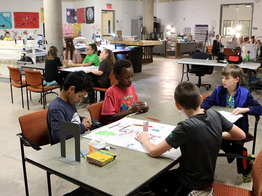 Campers team up to create a stop-motion film inside Stephens Central Library's new STEAM Central makerspace during the San Angelo Museum of Fine Arts' STEAM Spring Break Camp on Tuesday, March 14.