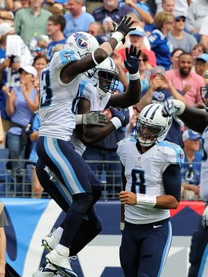 Titans quarterback Marcus Mariota, right, joins the touchdown celebration by wide receiver Dorial Green-Beckham in the third quarter.