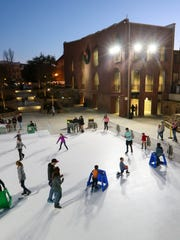 Skaters move around the Holiday Ice rink on Thursday at Carolina Wren Park in Anderson.