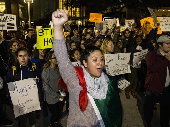 Demonstrators march on the Texas A&M University campus,