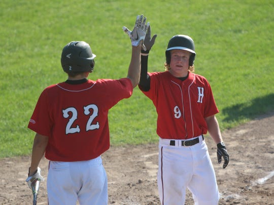 Sussex Hamilton junior Hunter Slaats (right) celebrates with teammates Ty Olejnik in a game against Marquette on June 29, 2018.