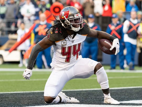 Nov 3, 2019; Seattle, WA; Tampa Bay Buccaneers running back Dare Ogunbowale celebrates after scoring a touchdown against the Seattle Seahawks at CenturyLink Field. Photo Credit: Steven Bisig - USA TODAY Sports)