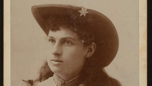 A collectible card of Annie Oakley shows  her shooting medals. The marksman's story is equal parts fact and myth.
