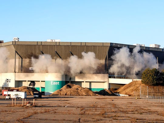 Smoke and dust come out of the Silverdome during  the implosion in Pontiac, Sunday, Dec. 3, 2017.