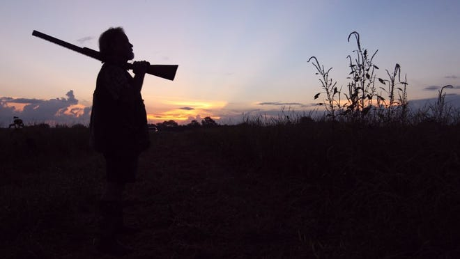 DAVID SIKES/CALLER-TIMES Kelly Gantt of New Braunfels watches an emerging sunrise as it illuminates a dove patch near Ricardo this past weekend.