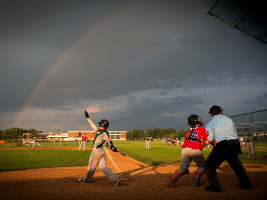 Fredericksburg's Hayden Johnson swings and hits a foul ball under a rainbow during the deciding game of the county Legion baseball Lefty Grumbine Championship Series Tuesday in Palmyra. Fredericksburg won the game and the title, 5-0.