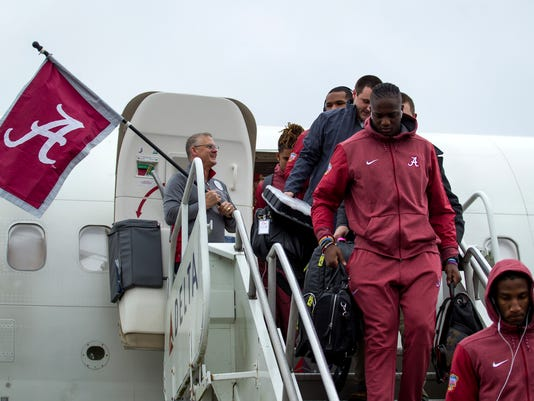 Alabama arrives Wednesday, Dec. 27, 2017, at Louis Armstrong International Airport in New Orleans. Alabama plays No. 1 Clemson in a semifinal playoff on New Year's Day in the Sugar Bowl. (Scott Threlkeld /The Advocate via AP)