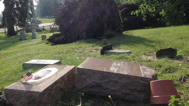 Headstones were knocked over and trees uprooted when a tornado went through the South Farmington Cemetery.