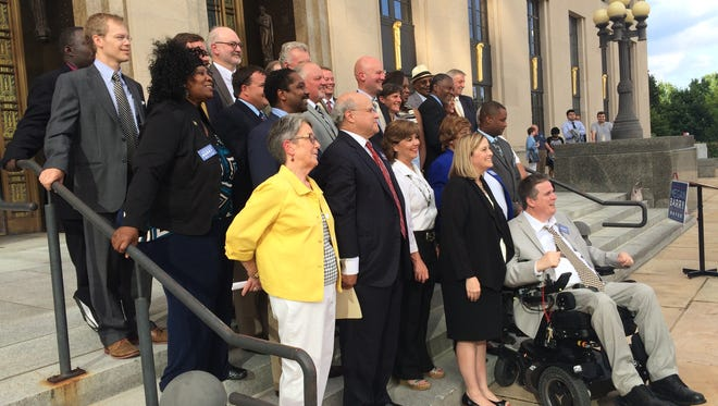 Megan Barry, front center, stands with current, former and future Metro Council members who announced their endorsements of her Tuesday.