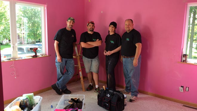 A group of people from Special Spaces-Green Bay working on Ellen's bedroom. Jason Micoley, Jerrid Sielaff, Melanie McKefry and Special Spaces Director Mike Bailey arrived early Friday.