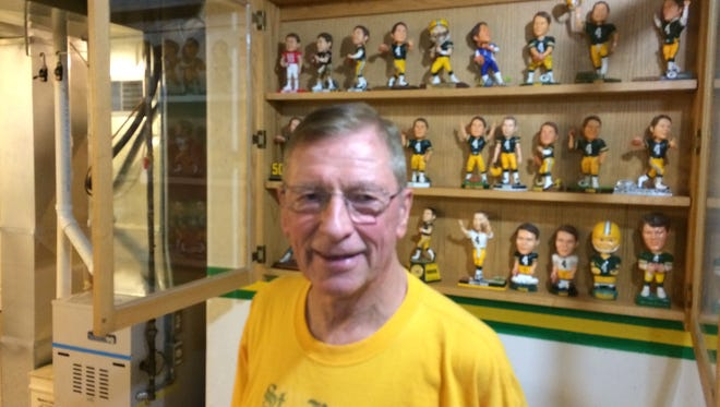 Lloyd Wettstein, 77, of Appleton stands among his Packer memorabilia collection, which includes a significant number of Brett Favre items.