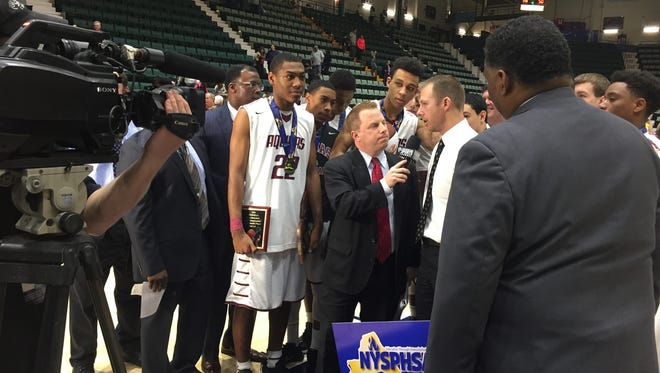 Aquinas junior Jalen Pickett with coach Michael Grosodonia and teammates after the 2016 NYSPHSAA Class AA boys basketball tournament final in Glens Falls, Warren County.