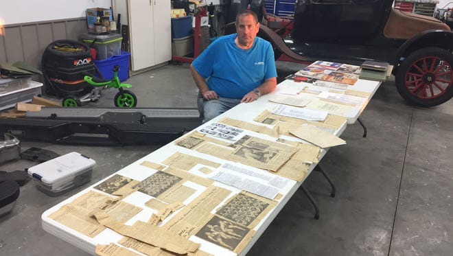 Mark Whitehead sits behind a table full of newspaper clippings detailing the standout basketball career of his father, Don, on Thursday in a pole barn at his Senate Avenue property.