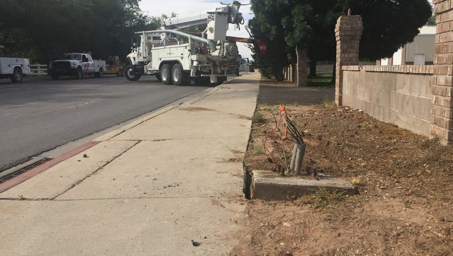 Fiber optic cable attached to a wooden pole were knocked down on the corner of North Canal Street and West Orchard Lane