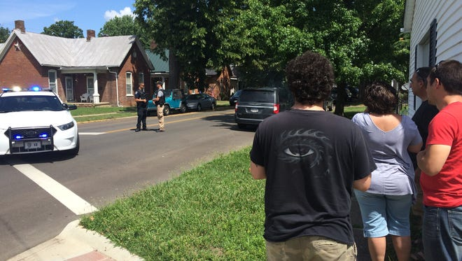 Family of Lucas Jackson's son wait to hear if police were able to get him to peacefully surrender from his Church Street home where he'd barricaded himself Monday morning.