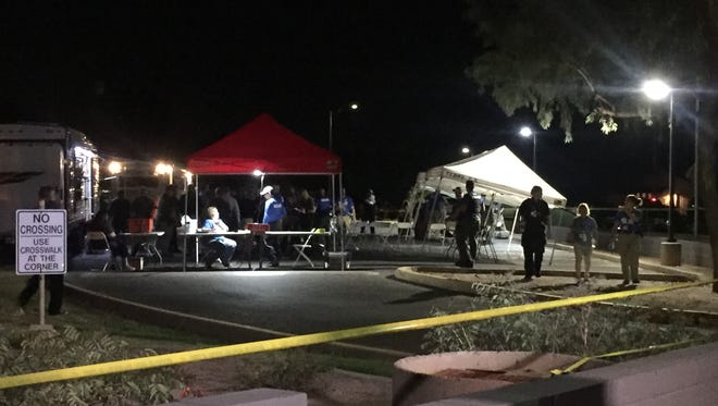 Police set up a command post at Hawthorne Elementary School in Mesa on Sept. 29, 2017, as part of a search for a missing 8-year-old girl. She was found safe the next day.