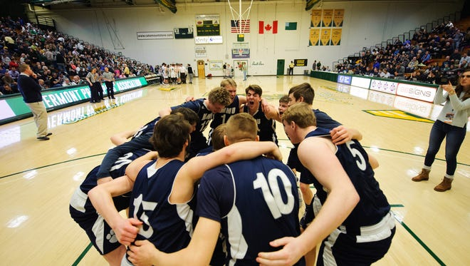 MMU huddles together during the Vermont state division I boys basketball semifinal game between the Mount Mansfield Cougars and the Rice Green Knights at Patrick Gym on Thursday night March 15, 2018 in Burlington.