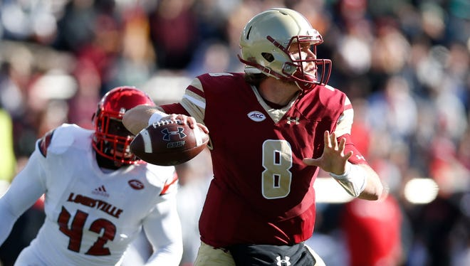 Nov 5, 2016; Boston, MA, USA; Boston College Eagles quarterback Patrick Towles (8) prepares to make a pass while pressured by Louisville Cardinals line backer Isaac Stewart (42) during the third quarter at Alumni Stadium.  The Louisville Cardinals won 52-7. Mandatory Credit: Greg M. Cooper-USA TODAY Sports