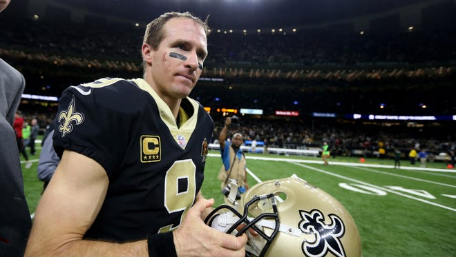 New Orleans Saints quarterback Drew Brees (9) walks off the field after their game against the Atlanta Falcons at the Mercedes-Benz Superdome.