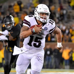 Mississippi State Bulldogs quarterback Dak Prescott (15) runs the ball against the Missouri Tigers during the second half at Faurot Field.
