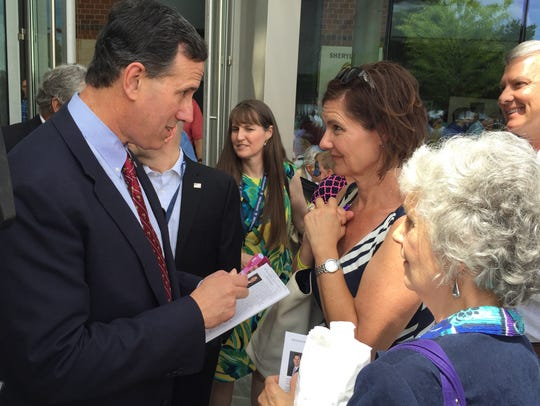 Rick Santorum signs autographs.