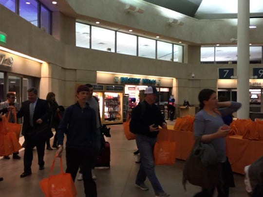 Passengers arrive at Palm Springs International Airport on the inaugural non-stop JetBlue Airlines flight from New York