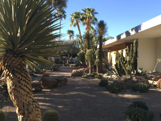 The Paul Boschetto residence in Rancho Mirage features a front yard filled with desert landscaping.