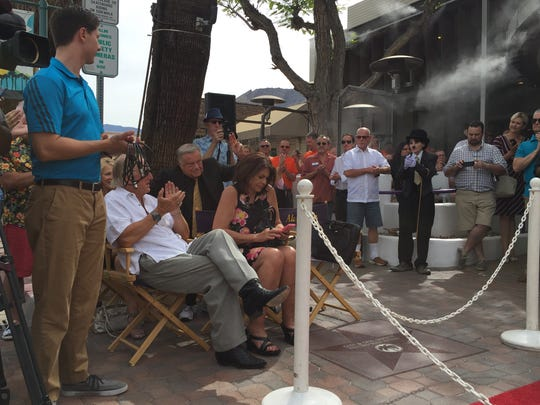 About 150 people gathered at the corner of Palm Canyon Drive and Arenas Road on Tuesday for the George Zander star ceremony where a granite star was laid in his name in the Palm Springs Walk of Stars.