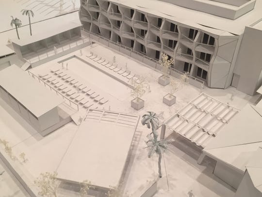 A scale model, where one inch equals eight feet, shows the new 66 hotel room addition proposed for the existing Hacienda Cantina & Beach Club. The Hacienda is on the right,.